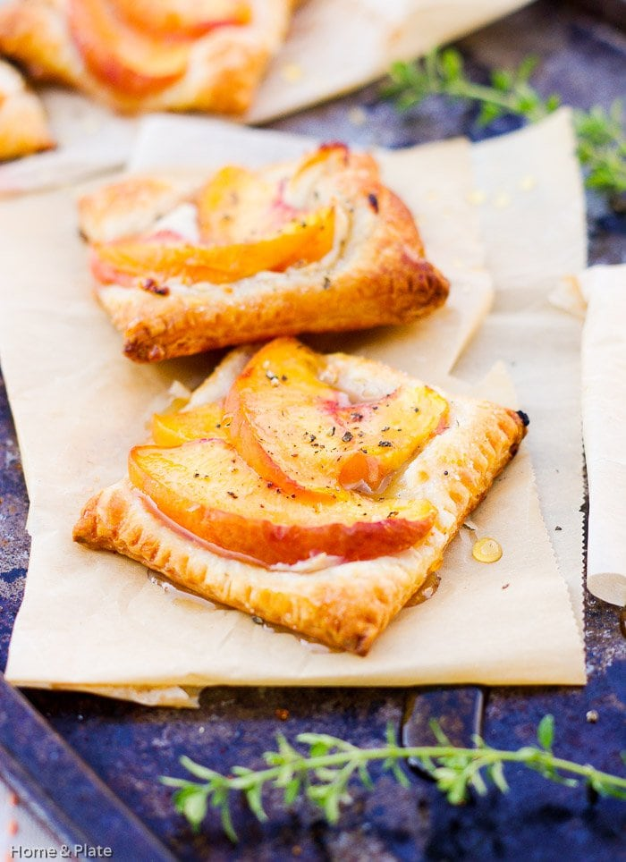 Peach Tarts with Goat Cheese & Honey | Home & Plate | www.homeandplate.com | The peachescaramelize beautifully and pair deliciously with the warm goat cheese.