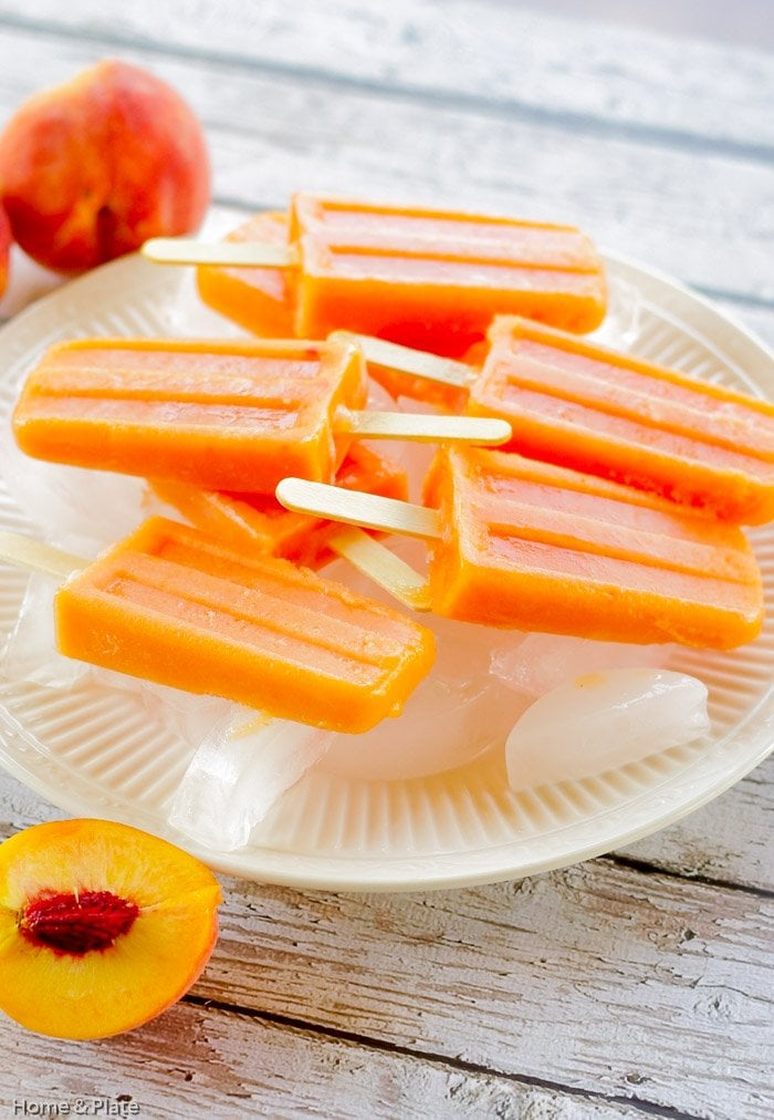Peach Ginger Ice Pops   Home & Plate   www.homeandplate.com   These ice popspromise that same summertime nostalgic feeling of biting into this sweet stone fruit.