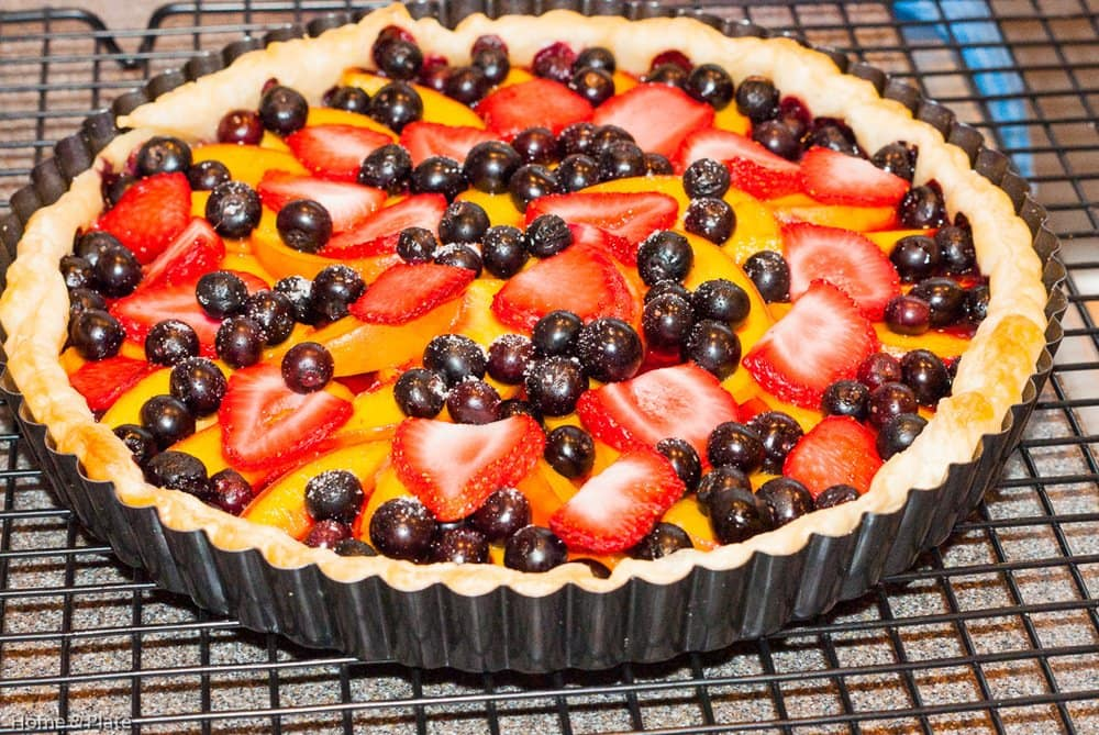 Classic Peach Tart with Summer Berries | Home & Plate | www.homeandplate.com | This easy summer fruit tart is the perfect dessert for any dinnerparty. Peaches, strawberries and blueberries are the stars of this show.
