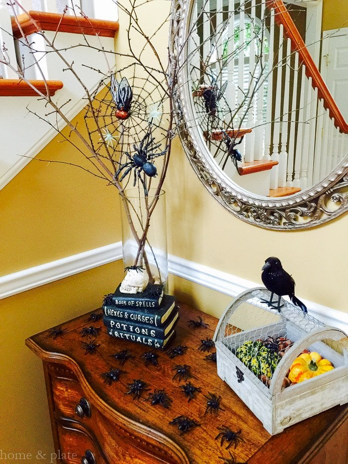 Spiders serve as the focal point for this easy Halloween decor. Dress up any foyer with easy to find items from the dollar store | www.homeandplate.com