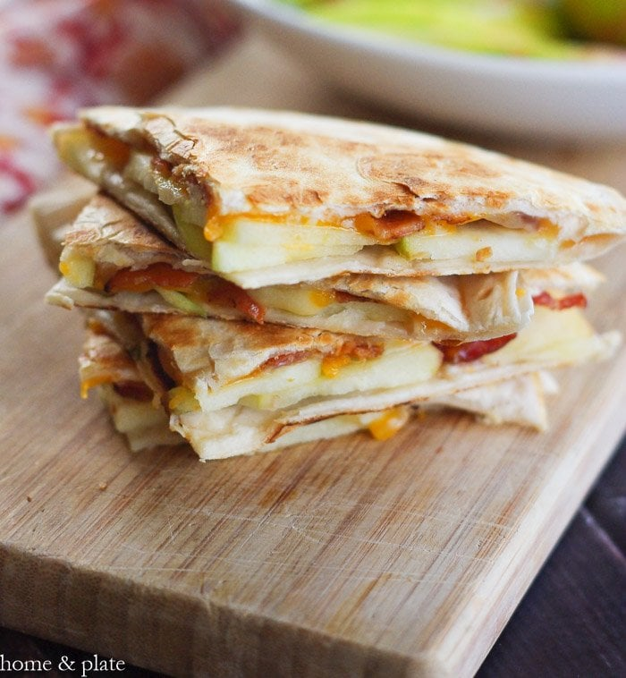 Honeycrisp Apple Quesadillas with Bacon and Cheddar   www.homeandplate.com   These honeycrisp apple quesadillas with bacon and cheddar are the perfect lunch or snack and they are school and kid friendly.