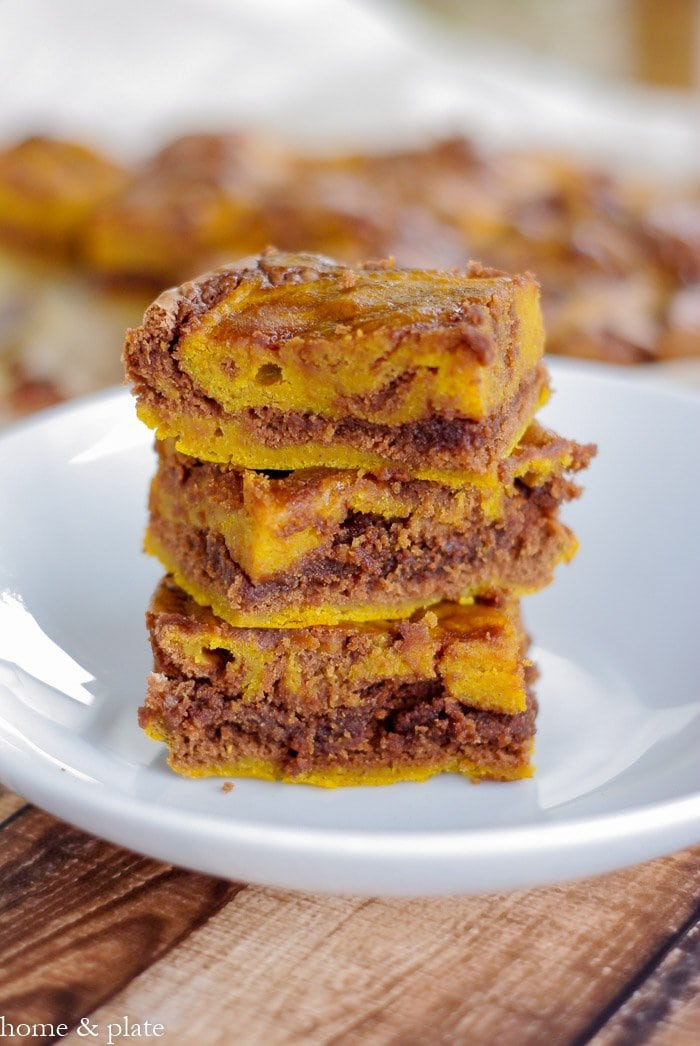 Marbled Pumpkin Chocolate Brownies | www.homeandplate.com | Transform a box of chocolate brownie mix into a decadent fall dessert by adding sweet canned pumpkin.