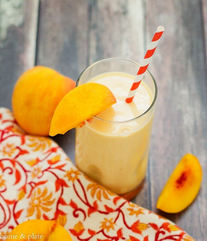 Fresh Picked Sweet Peach Smoothie | www.homeandplate.com | Did you know peaches are a great source of protein? Add in Greek yogurt, mix it all together and you have yourself a power breakfast.