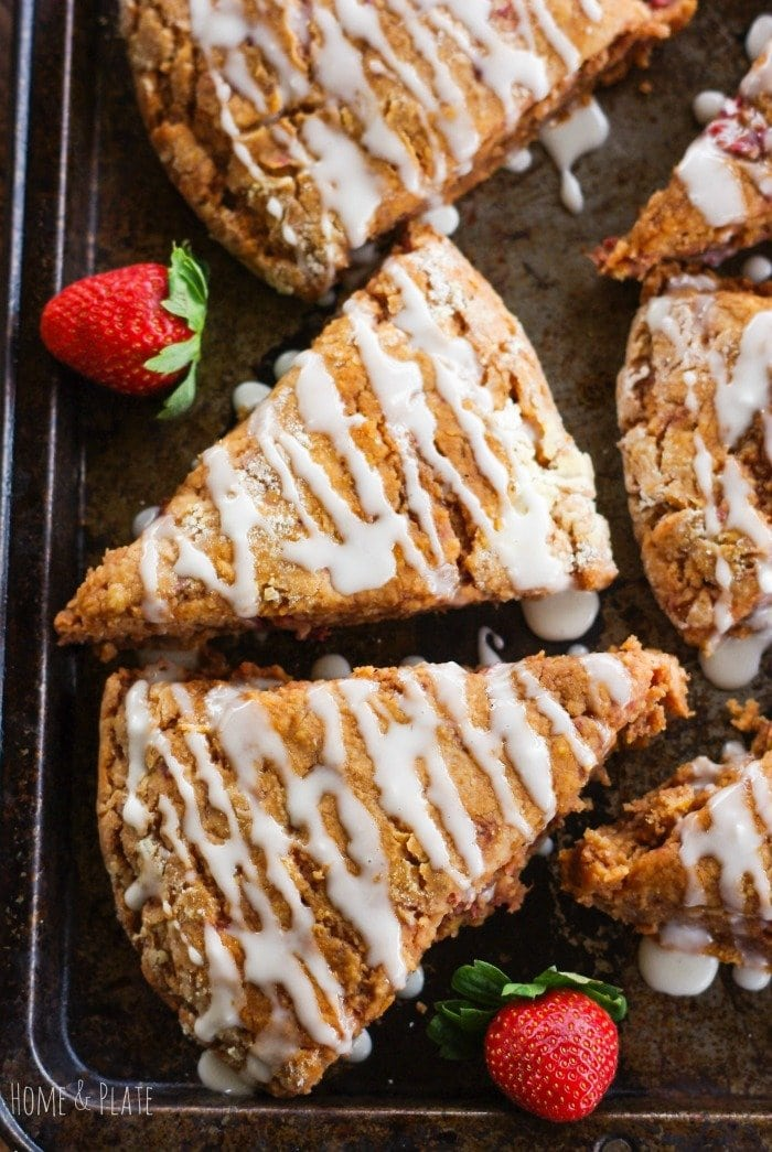 Whole-Wheat Strawberry Ricotta Scones with a Lemon Glaze | www.homeandplate.com | Treat yourself to something delicious this holiday season featuring whole-grain goodness, fresh sweet strawberries and tangy lemon peel.