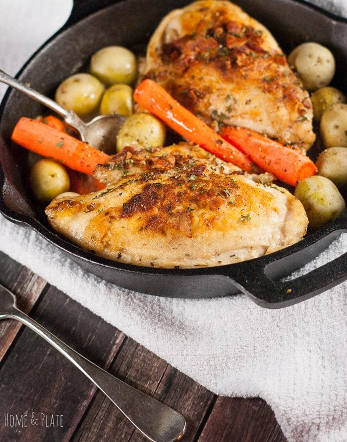 Roasted chicken with carrots and potatoes in a Cast Iron Skillet
