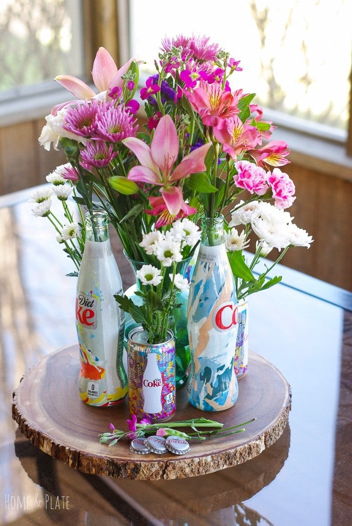 "Stunning Floral Centerpiece featuring Diet Coke ""It's Mine"" Bottles"