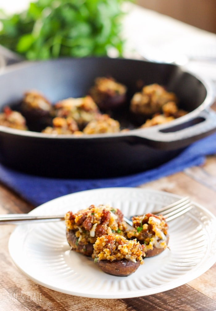 Chorizo & Manchego Stuffed Mushrooms | www.homeandplate.com | Add a little Mexican zing to your next batch of stuffed mushroom with the spicy flavor of fresh chorizo sausage and nutty Manchego cheese.