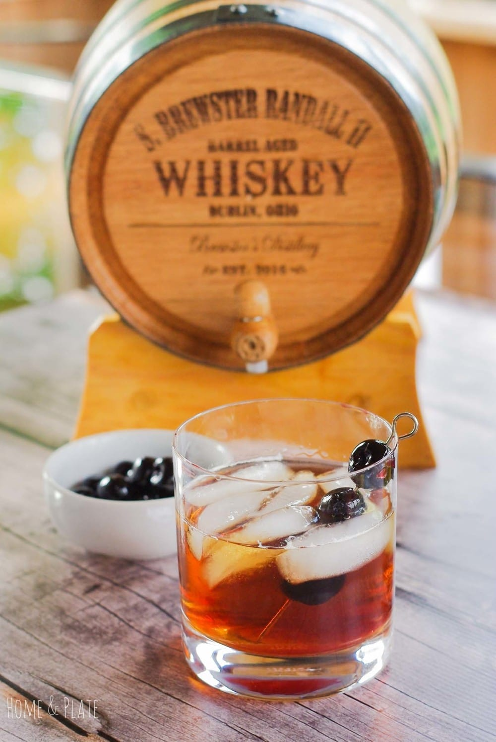 Barrel-Aged Bourbon Manhattan | www.homeandplate.com | A 5-liter miniature oak barrel is the perfect size for accentuating the flavor of quality whiskeys and bourbons. If you
