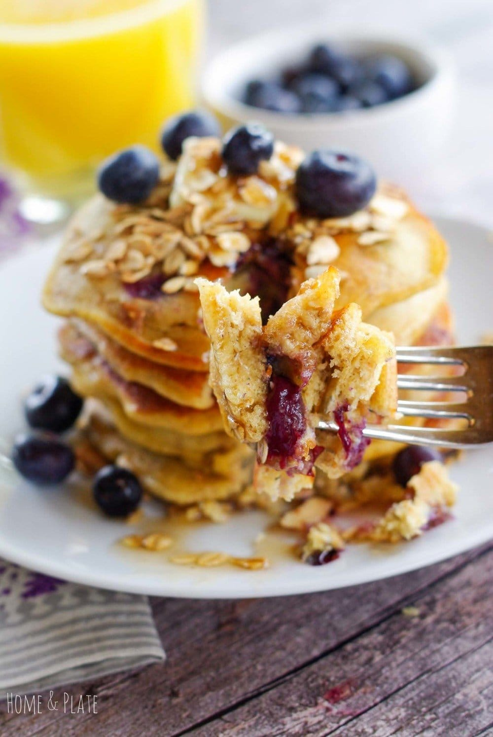 Blueberry Granola Pancakes | www.homeandplate.com |Add a little crunch to your morning routine by adding granola to your standard blueberry pancakes.
