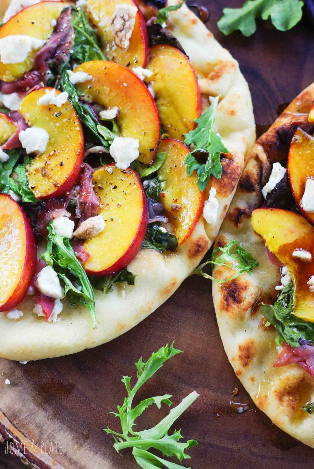 Grilled Nectarine Prosciutto Pizza | www.homeandplate.com | Sweet juicy nectarines paired with salty prosciutto and creamy goat cheese turns an ordinary pizza into something phenomenal.