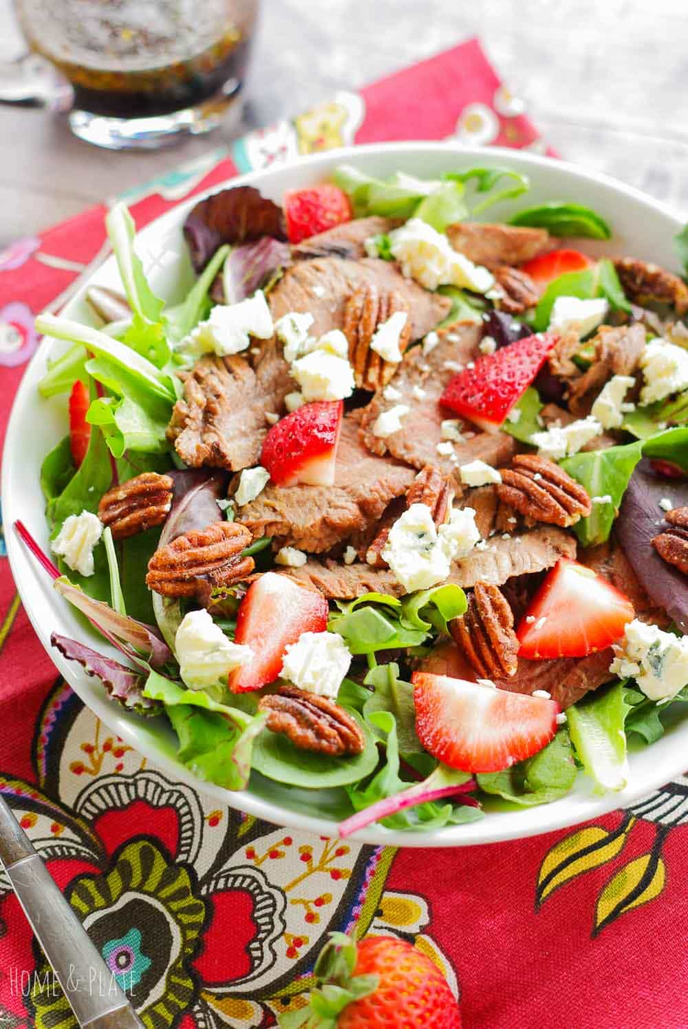 Steak Salad with Strawberries on a red napkin