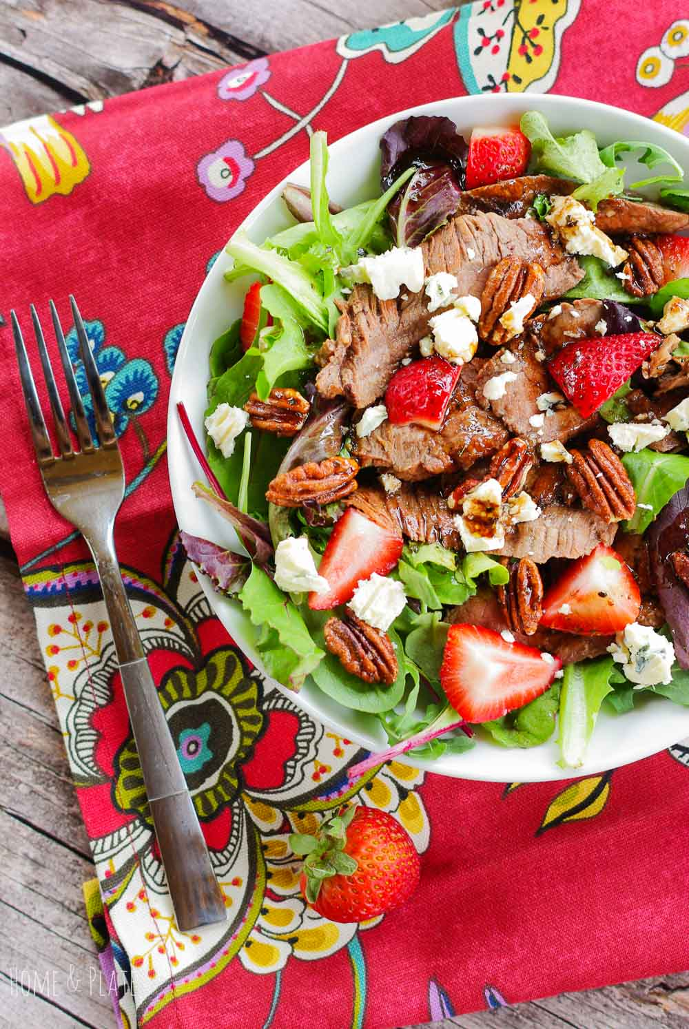 A Flank Steak Salad next to a fork