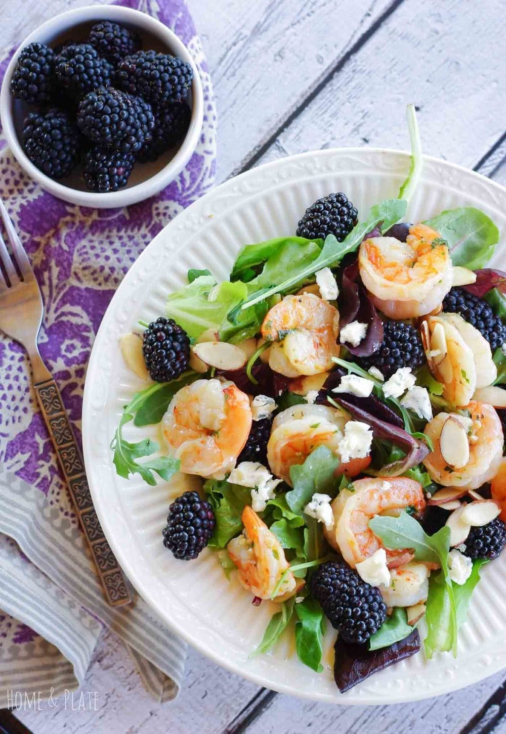 Grilled Shrimp Salad with Blackberries | www.homeandplate.com | Fresh shrimp grilled pink to perfection is the perfect source of protein for any summer salad. Toss in some nectar sweet blackberries, crunchy almonds and crumbled blue cheese for a lunch worthy meal.