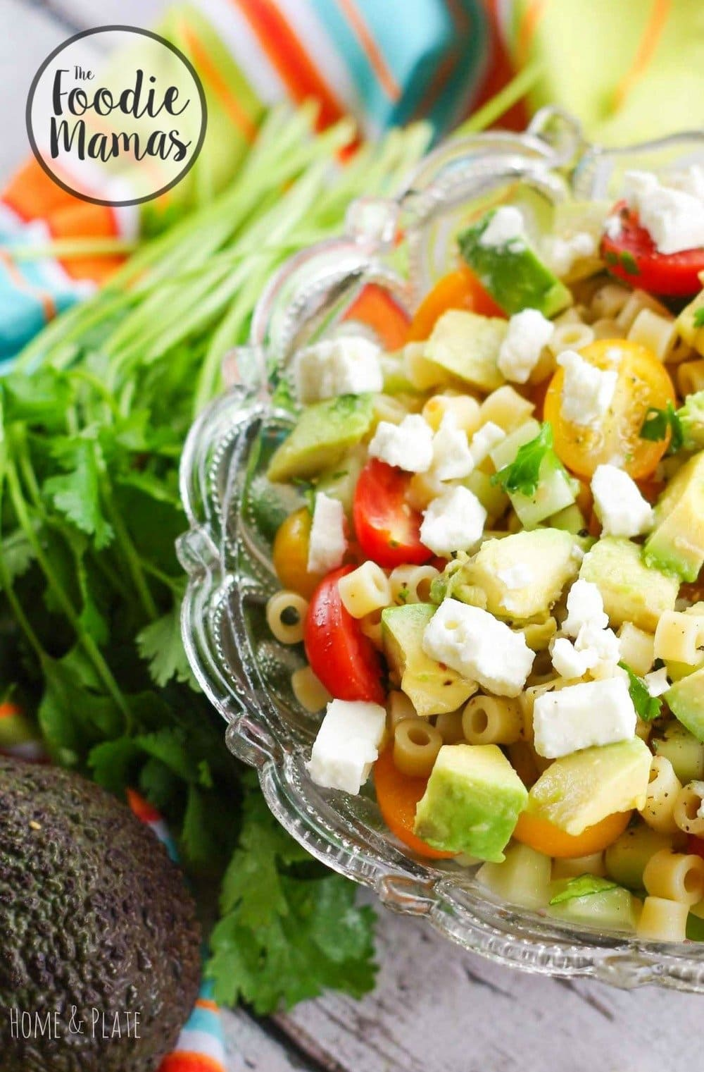 Greek Avocado Pasta Salad | www.homeandplate.com | Keep it cool this summer with this Greek avocado pasta salad featuring summer