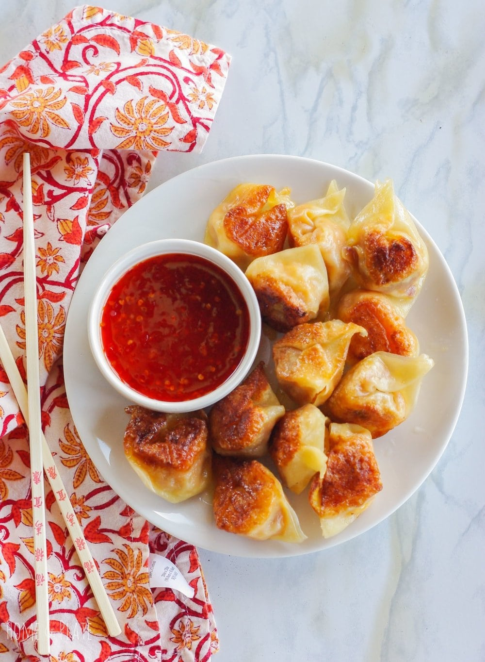 Butternut Bacon Potstickers | www.homeandplate.com | Sweet butternut squash is paired with salty bacon in these easy to make party appetizer.