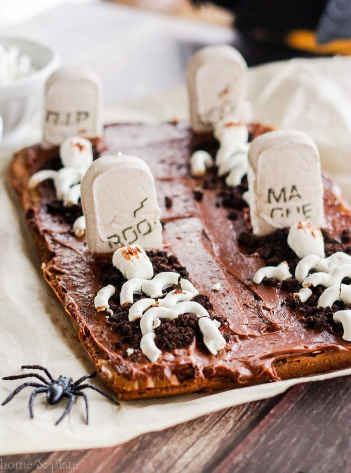 Sheet of brownies decorated as a graveyard with tombstones