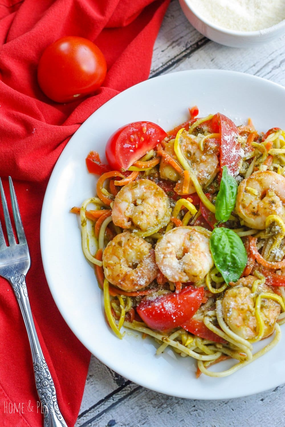 Basil Pesto Vegetable Pasta with Shrimp | www.homeandplate.com | Need a quick dinner? Make a big bowl of pasta filled with fresh vegetables, flavored with basil pesto and sautéed shrimp.