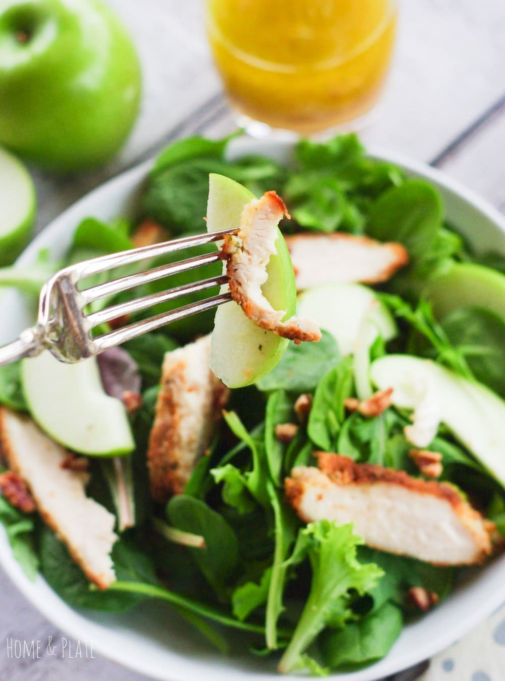Granny Smith Apple Pecan Chicken Salad | www.homeandplate.com | Tart Granny Smith apples, meaty pecans and breaded chunks of chicken are topped with a homemade honey orange balsamic vinaigrette.