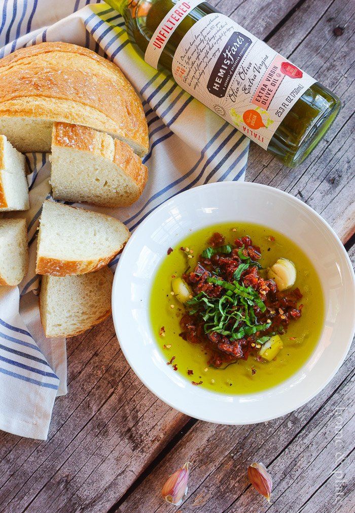 #ad | Sun Dried Tomato Dipping Oil | www.homeandplate.com | Extra virgin olive oil, sun dried tomatoes, fresh garlic, homegrown basil and Parmesan cheese makes up this bread dipping oil.