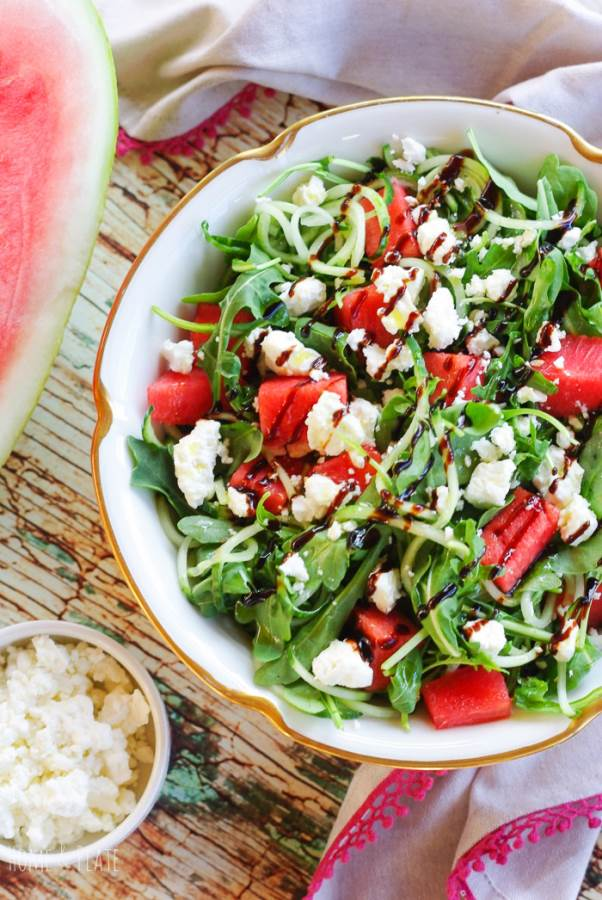 Watermelon Arugula Salad | Sweet watermelon, juicy cucumber and salty feta cheese are the perfect flavor combination nestled on top of tangy arugula. | www.homeandplate.com