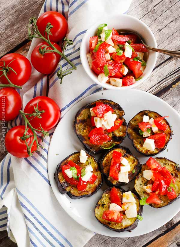 Grilled Eggplant with a Tomato Caprese | Home & Plate | www.homeandplate.com | Nothing spell summer more so than grilled eggplant topped with ripe tomatoes, creamy mozzarella cheese and fresh basil.