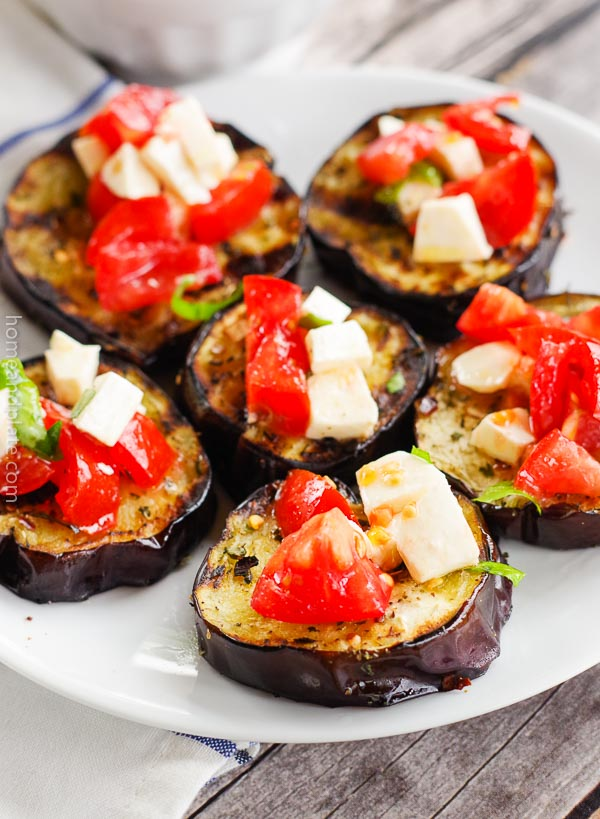 Grilled Eggplant with a Tomato Caprese | Home & Plate | www.homeandplate.com | Nothing spell summer more so than grilled eggplant topped with ripe tomatoes, creamy mozzarella cheese and fresh basil. #eggplant #caprese