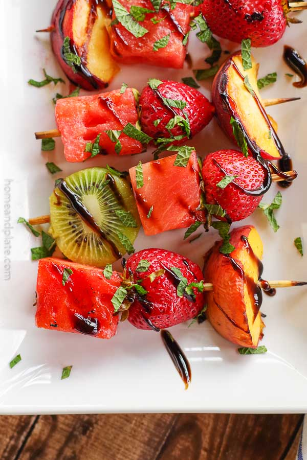 Grilled Fruit Kabobs | www.homeandplate.com | Grill your favorite summer fruits and drizzle them with mint and balsamic glaze.