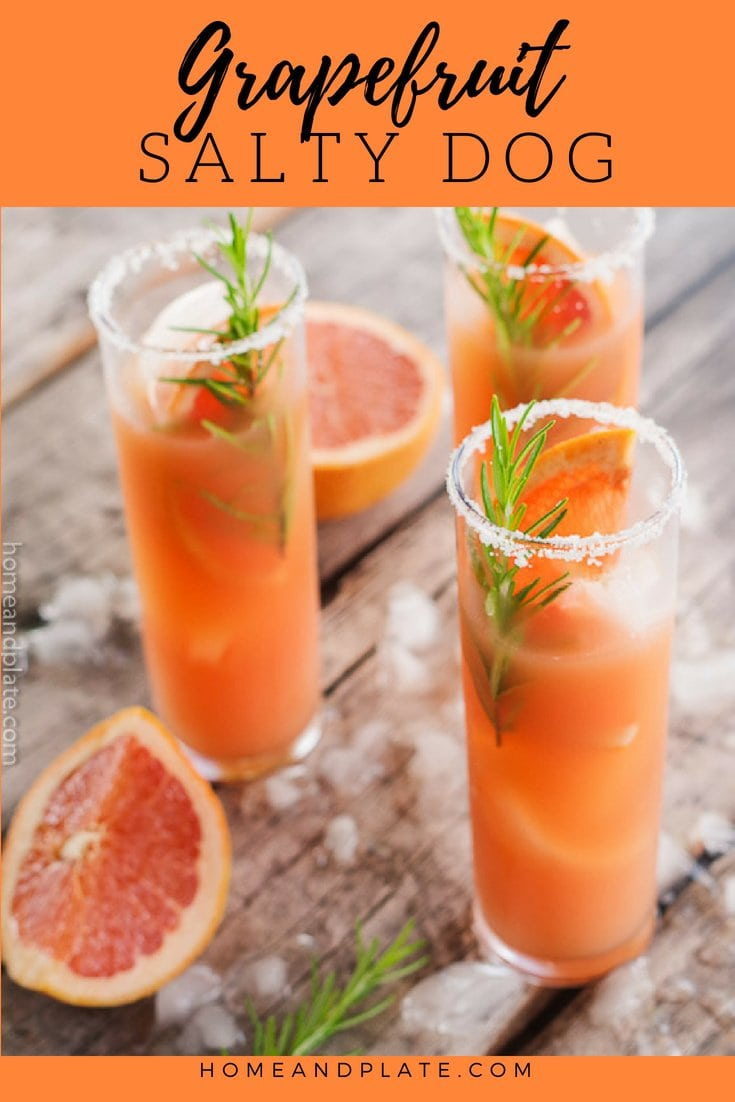 Grapefruit Salty Dog Cocktails surrounded by ice cubes, rosemary sprigs and grapefruit wedges