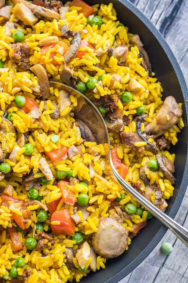 Chorizo & Chicken Rice Skillet | This 30 minute recipe features spicy chorizo sausage, tender chicken and vegetables infused in saffron flavored rice.