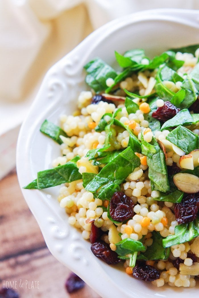 Close up of spinach, couscous and cherries