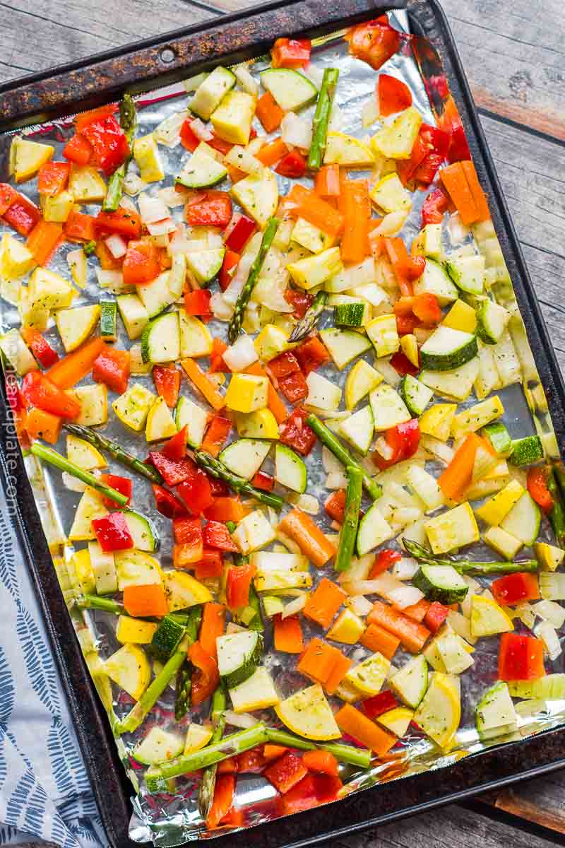 Overhead view of sheet pan of chopped vegetables