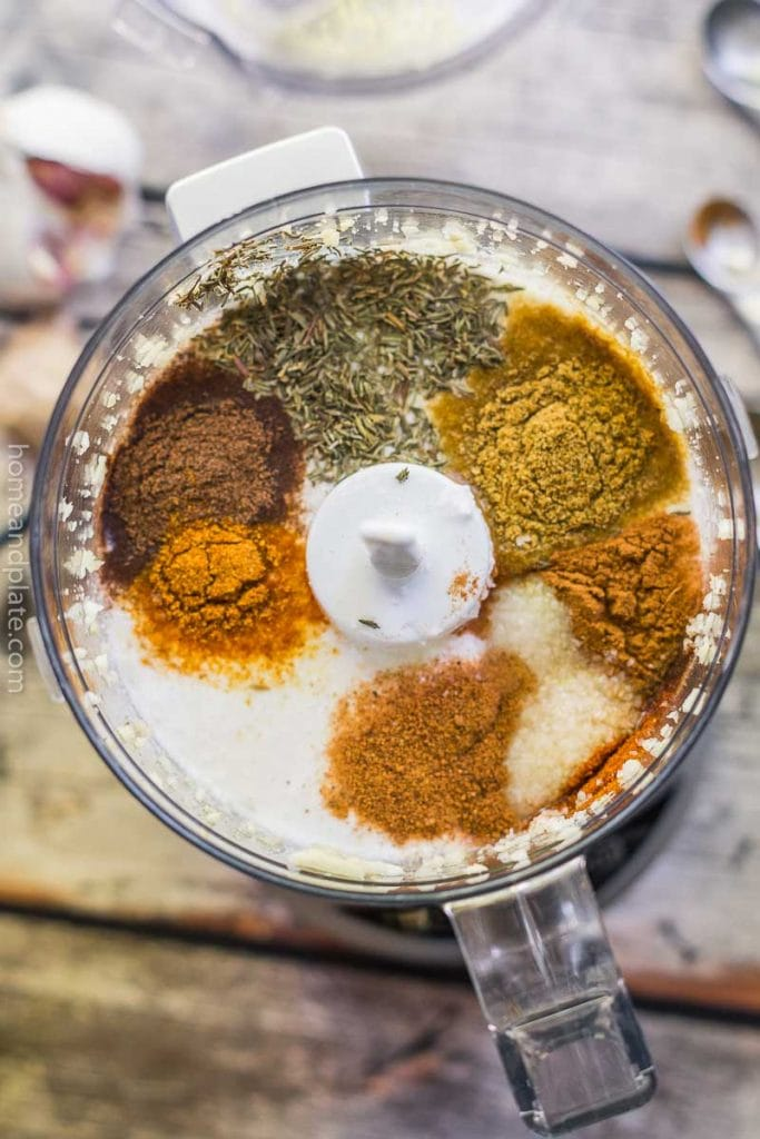 Spices and coconut milk in blender