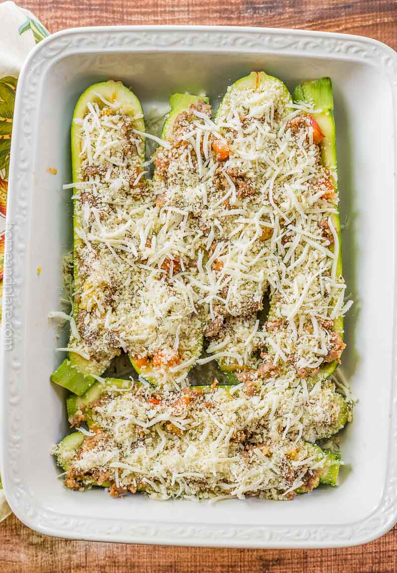 Zucchini boats with shredded cheese on top