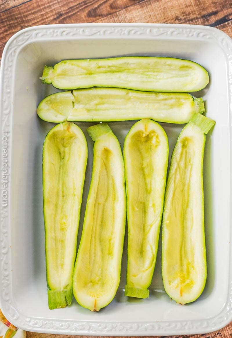 Casserole pan holding scooped out zucchini