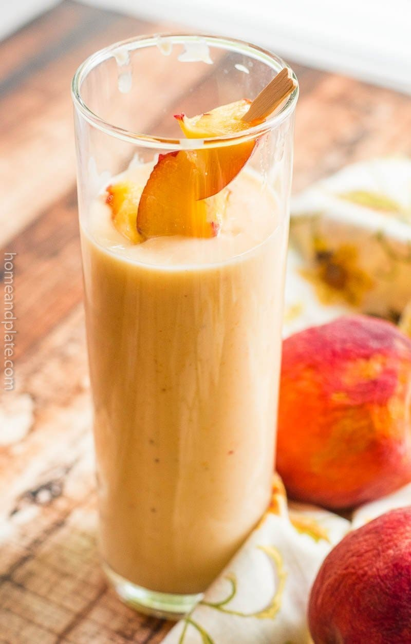 Close up of a banana peach smoothie on a table