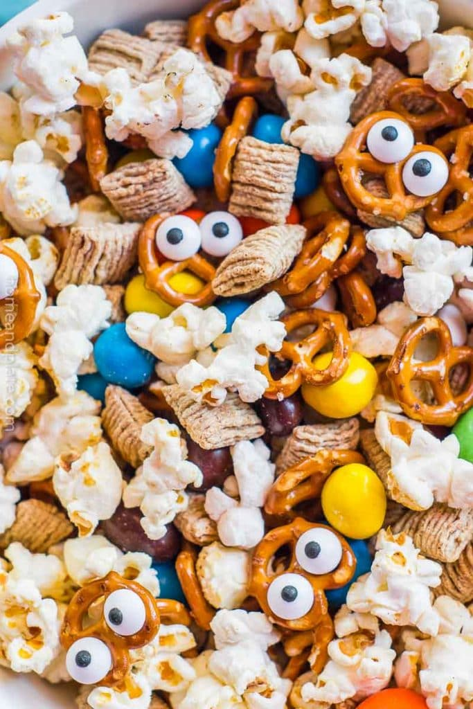 Close up of poopcorn, pretzels and candy