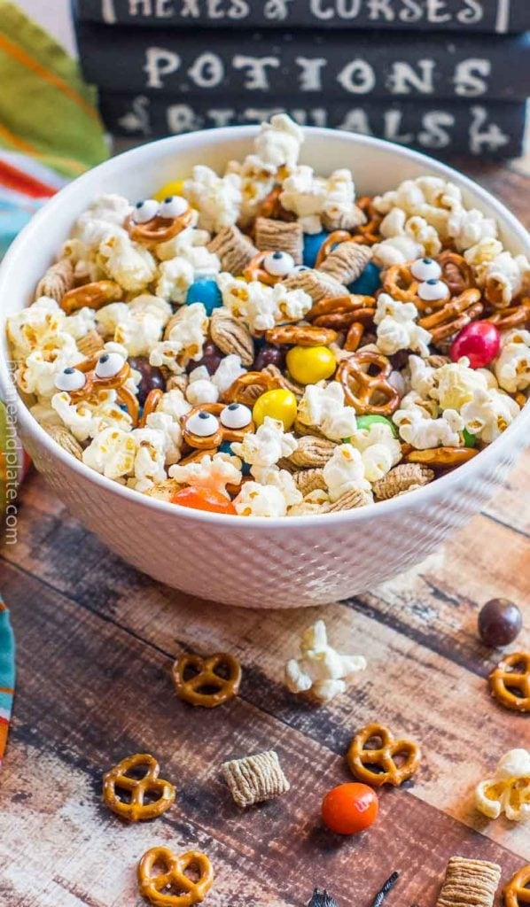 Bowl of Halloween snack mix on wooden surface