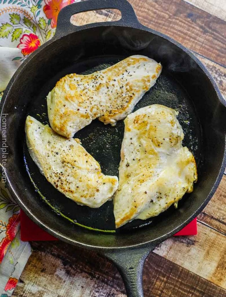 Cooked chicken in a cast iron skillet