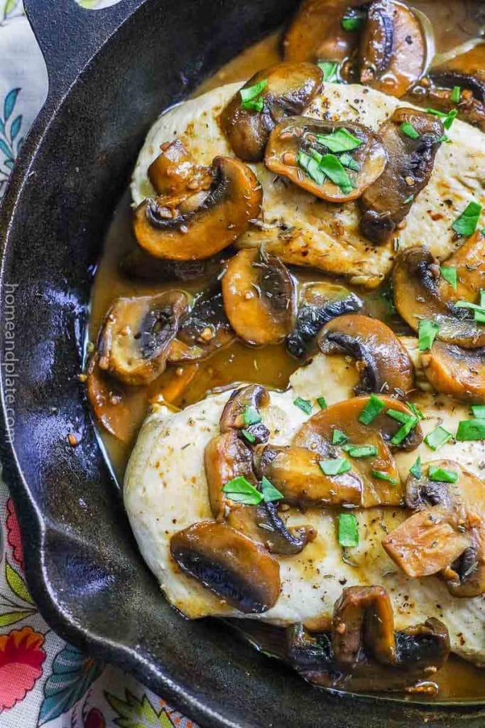 Close up of cooked chicken with sauteed mushrooms
