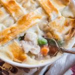 Fork placed inside a bowl of chicken pot pie