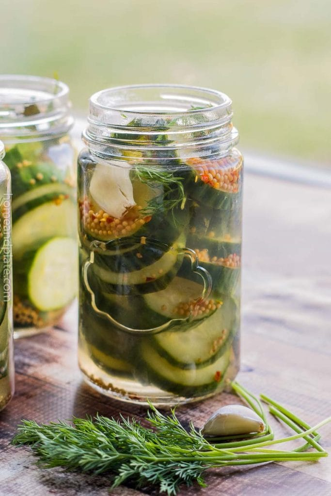 A canning jar of pickles on a table top