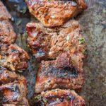 Close up of steak kabobs on abaking sheet