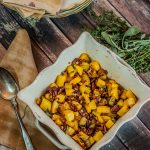 Casserole pan with roasted butternut squash cubes